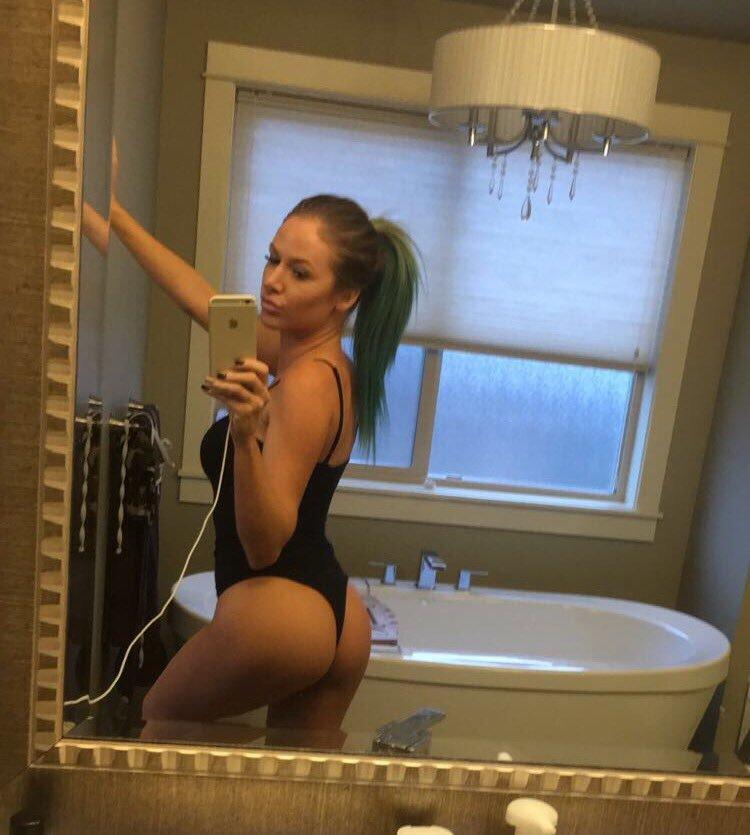 Jenna Jones in black thong swimsuit takes hot selfie
