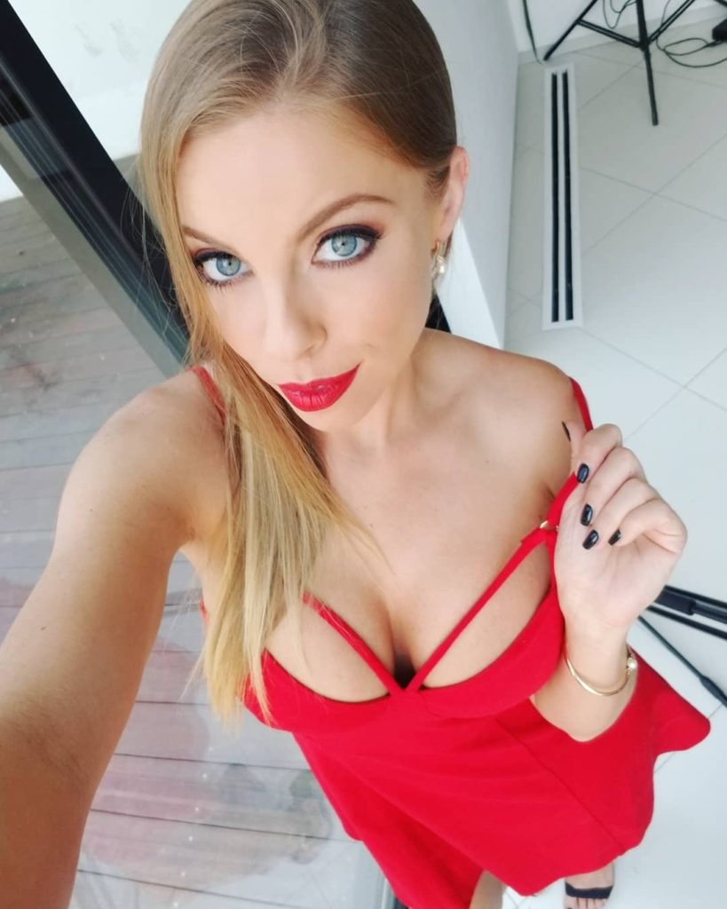 Britney Amber in red dress takes selfie