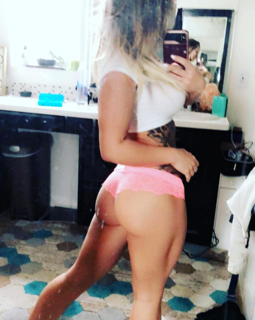 Cali Carter in pink thong takes selfie showing her sexy booty