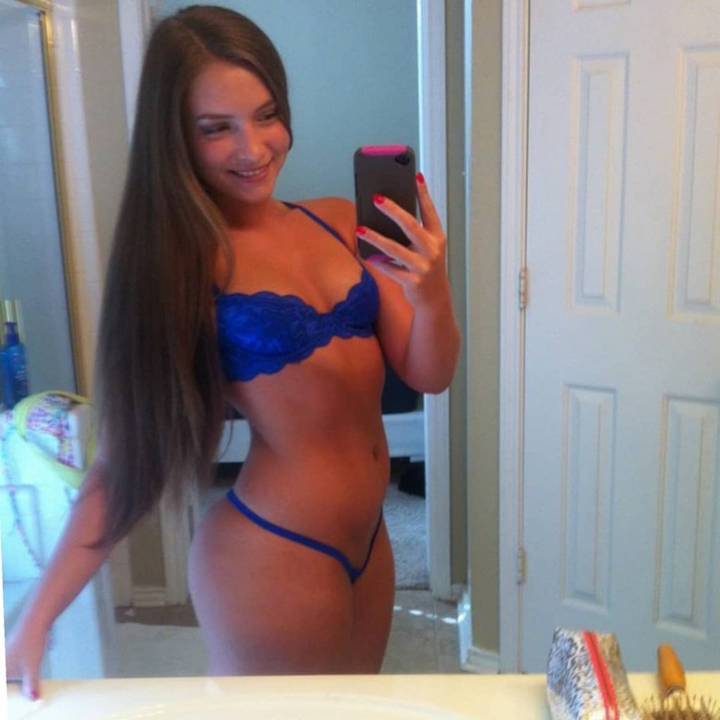 Mandy Kay in blue lingerie taking selfie