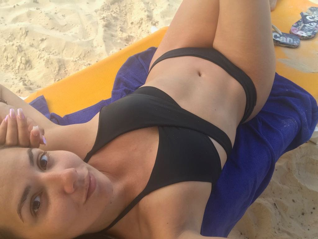 bikini selfie at the beach by Camsoda.com webcam model April Santorini