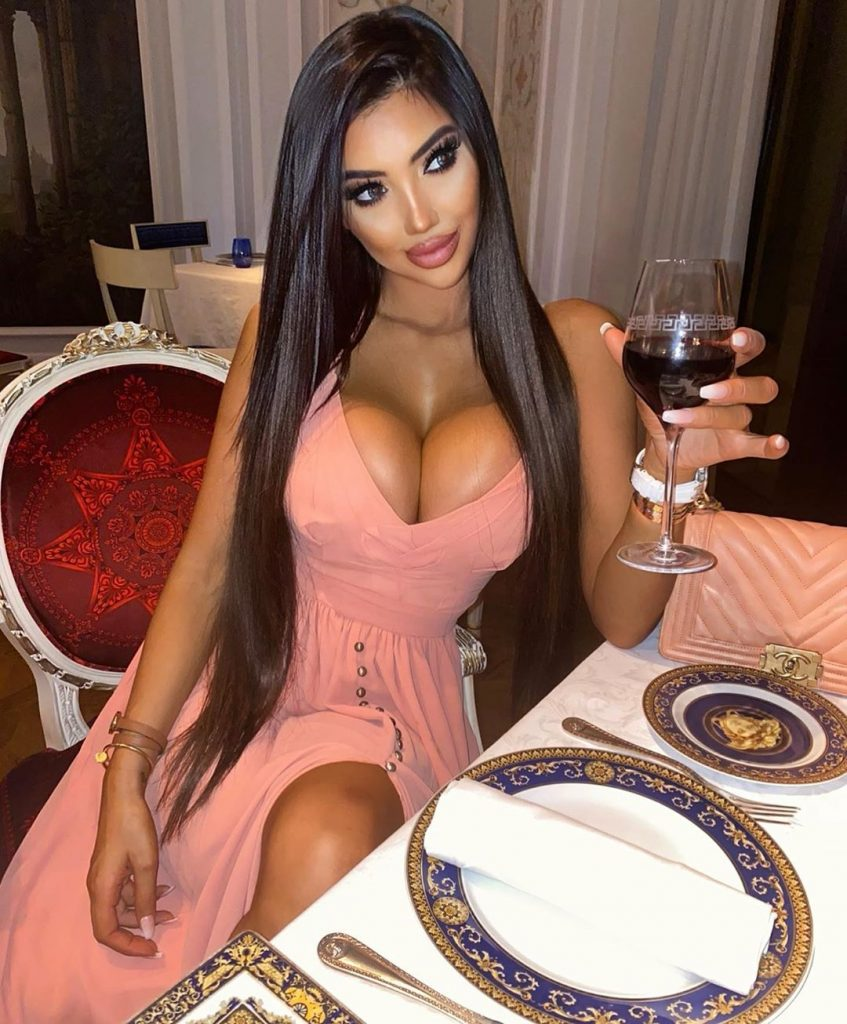 British celebrity Chloe Khan shows cleavage in hot dress at dinner